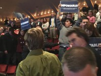 A group of DREAMer protesters attempted to disrupt the speech of former Texas Gov. Rick Perry at the Iowa Freedom Summit this afternoon. They were escorted from the building, but continued to cause a disruption in the front lobby. A single protester then tried to disrupt the speech of New Jersey Gov. Chris Christie.