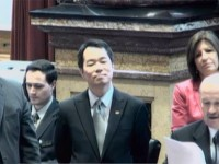 Taipei Economic and Cultural Office Director General Calvin Chen-huan Ho, center, was on hand as state Sen. Bill Dotzler (D-Waterloo) read Senate Resolution 21.
