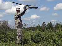 Iowa Army National Guard Spc. Jared McKenna, Company A, 1st Battalion, 133rd Infantry, 2nd Brigade Combat Team, 34th Infantry Division, from Dubuque prepares to launch an Unmanned Aerial Vehicle (UAV), at Fort Polk, La., during annual training at the Joint Readiness Training Center, July 28. McKenna is a certified operator and navigator for the reconnaissance aircraft. (Iowa National Guard Photo by Sgt. Renee Seruntine)