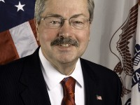 Branstad clears the stack of bills on his desk